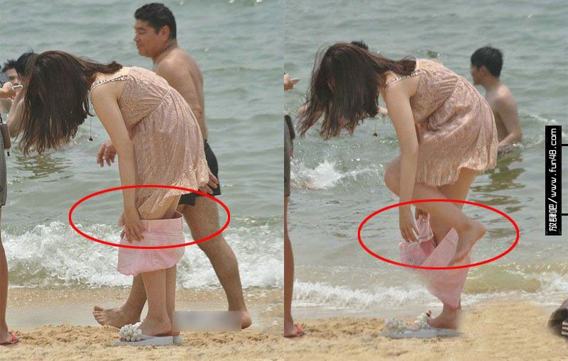 海边美女当众脱裤